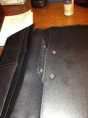 Opened flap showing popper which can hold Filofax paper. Photograph by Jim Russo