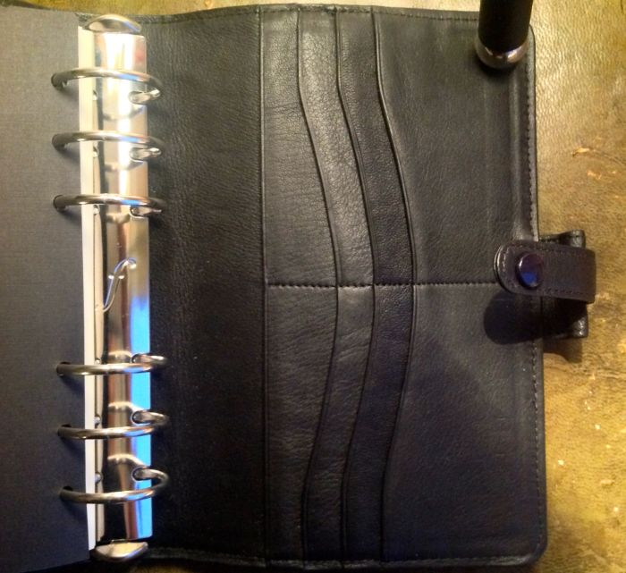 The credit card pockets in this one are in the back, while the zippered pocket is in the front.