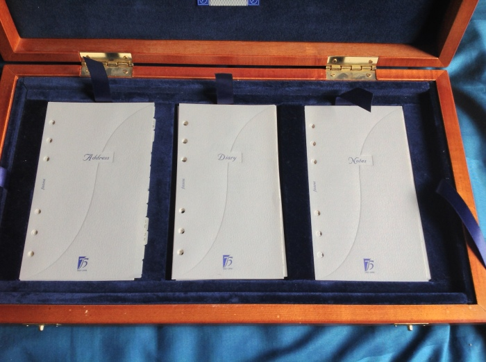 The inserts with their covering paper - each has a beautiful f design embossed onto the card.