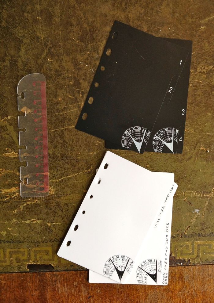 Pretty plastic dividers in black and white with a transparent and pink ruler