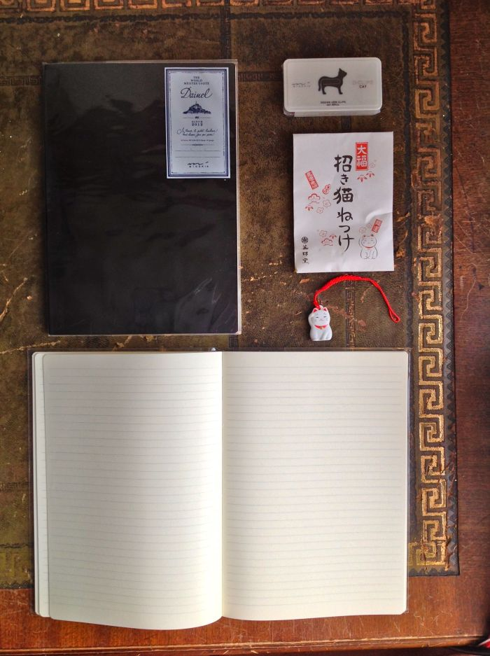 2 Midori A5 notebooks with 'leather paper' covers under plastic covers. I got one pink and one black but they also had grey, brown, blue, and greens of various shades.