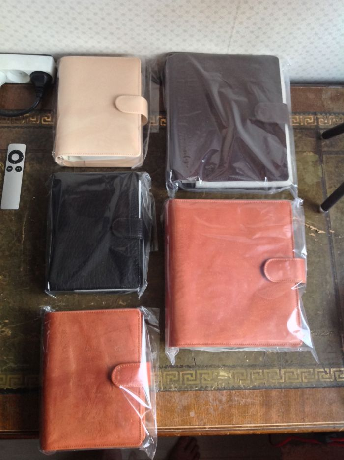 Clockwise starting from top left: personal sized undyed, A5 brown Touch Me, A5  Janet Leather (#104), Personal  Janet Leather (#104) , black personal Touch Me