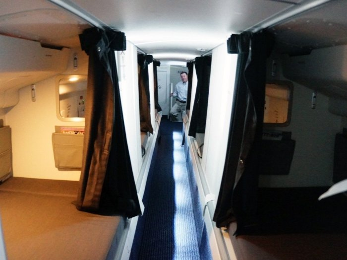 to-get-back-out-to-the-main-cabin-an-emergency-exit-under-one-of-the-beds-leads-straight-into-the-cabin-through-an-overhead-bin-thats-locked-from-the-outside