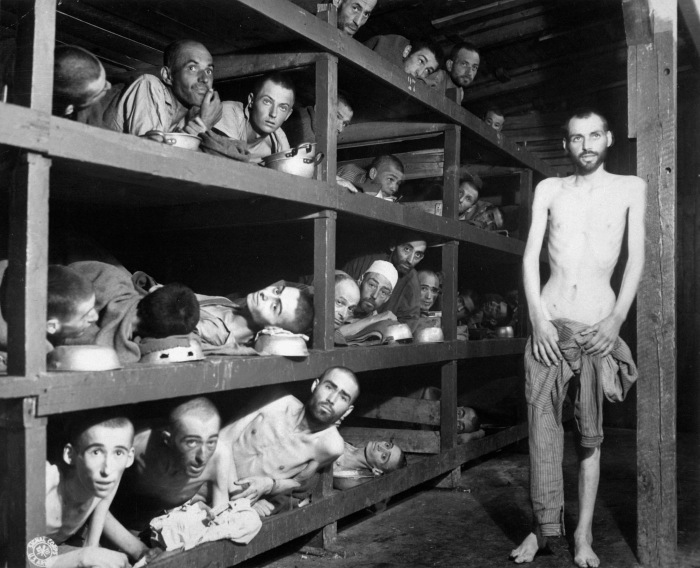 These are slave laborers in the Buchenwald concentration camp near Jena; many had died from malnutrition when U.S. troops of the 80th Division entered the camp. Germany, April 16, 1945. Pvt. H. Miller. (Army) NARA FILE #: 208-AA-206K-31 WAR & CONFLICT BOOK #: 1105